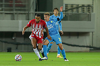 PIRAEUS, GREECE - OCTOBER 21: Youssef El-Arabi of Olympiacos FC and Valentin Rongier of Olympique de Marseille during the UEFA Champions League Group C stage match between Olympiacos FC and Olympique de Marseille at Karaiskakis Stadium on October 21, 2020 in Piraeus, Greece. (Photo by MB Media)