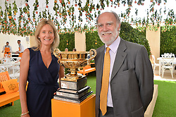 VISCOUNT & VISCOUNTESS COWDRAY at the Veuve Clicquot Gold Cup Final at Cowdray Park Polo Club, Midhurst, West Sussex on 20th July 2014.