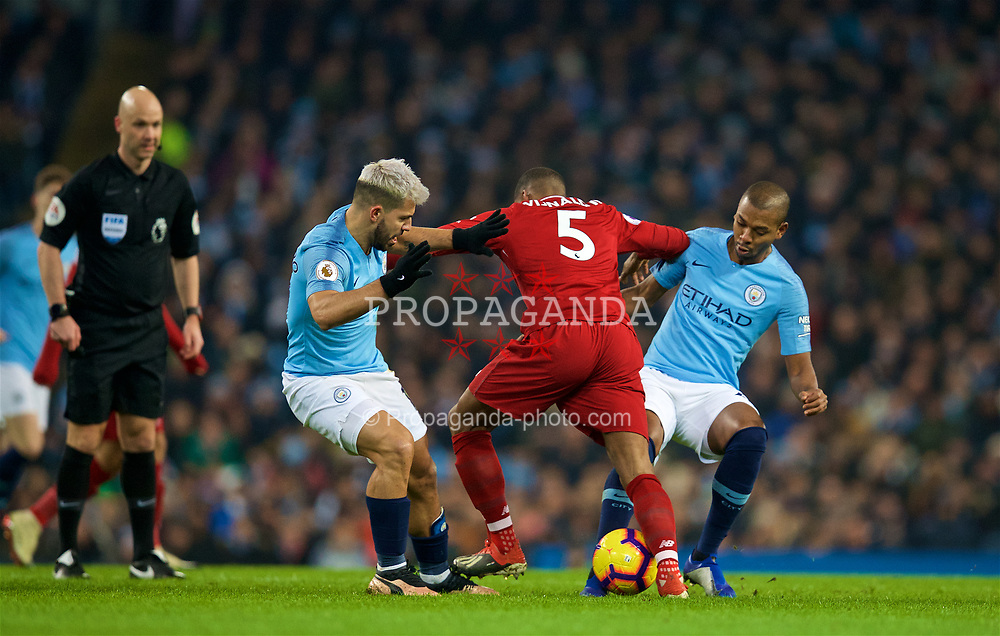 MANCHESTER, ENGLAND - Thursday, January 3, 2019: Liverpool's Georginio Wijnaldum is tackled by Manchester City's Sergio Aguero (L) during the FA Premier League match between Manchester City FC and Liverpool FC at the Etihad Stadium. (Pic by David Rawcliffe/Propaganda)
