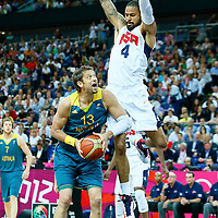 08 August 2012: USA Tyson Chandler jumps to block Australia David Andersen during 119-86 Team USA victory over Team Australia, during the men's basketball quarter-finals, at the 02 Arena, in London, Great Britain.