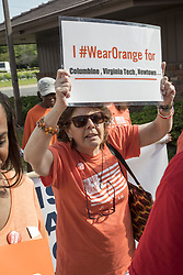June 3, 2017 - Detroit, Michigan, U.S. - Detroit, Michigan USA - 3 June 2017 - Members of Moms Demand Action march to end gun violence. Participants chose orange as their color, adopted from the safety orange worn by hunters. (Credit Image: © Jim West via ZUMA Wire)