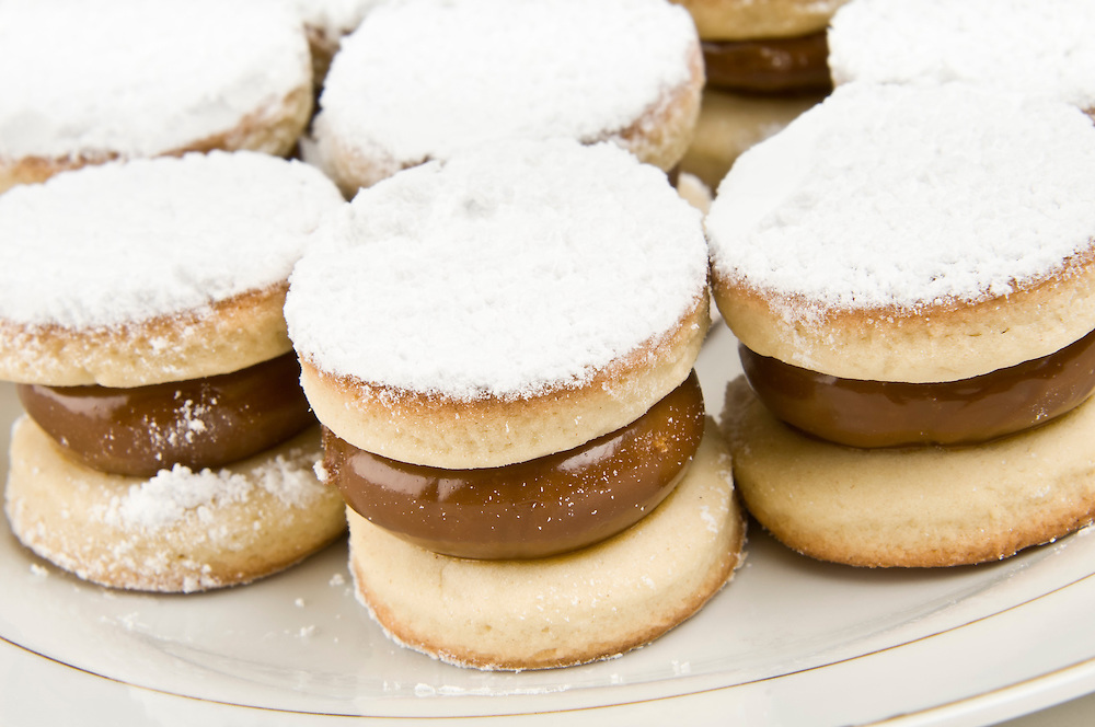 Plate of cornflour cookies filled with caramel.