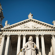 The front facade of St Paul's Cathedral, one of the most distinctive of London's landmarks. There has been a church on this site since 604 AD. The current building, with it's massive dome, was designed by Christopher Wren and dates back to the late 17th century. The focus is on the statue of Queen Victory in the foreground.