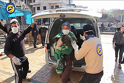 April 4, 2017 - Khan Sheikhoun, Idhib Province, Syria - Syrian Civil Defense aka the White Helmets, helping young child victim, after morning attack of a suspected serious lethal gas (most likely sarin nerve gas), in rebel-held Idlib Province in northwestern Syria, near Turkey (population 165,000). A score wounded and over dozen already dead, others might die shortly as a after effect of exposure to deadly gases. The inhabitants are overwhelmingly Sunni Muslims, although there is a significant Christian minority. (Credit Image: © Syria Civil Defense via ZUMA Wire)
