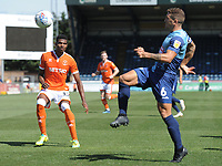 Blackpool's Michael Nottingham watches on as Wycombe Wanderers' Adam El-Abd clears<br /> <br /> Photographer Kevin Barnes/CameraSport<br /> <br /> The EFL Sky Bet League One - Wycombe Wanderers v Blackpool - Saturday 4th August 2018 - Adams Park - Wycombe<br /> <br /> World Copyright © 2018 CameraSport. All rights reserved. 43 Linden Ave. Countesthorpe. Leicester. England. LE8 5PG - Tel: +44 (0) 116 277 4147 - admin@camerasport.com - www.camerasport.com