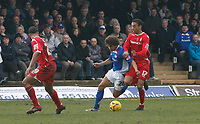 Jamie Jackson of Chesterfield is fouled by Forest defender James Perch