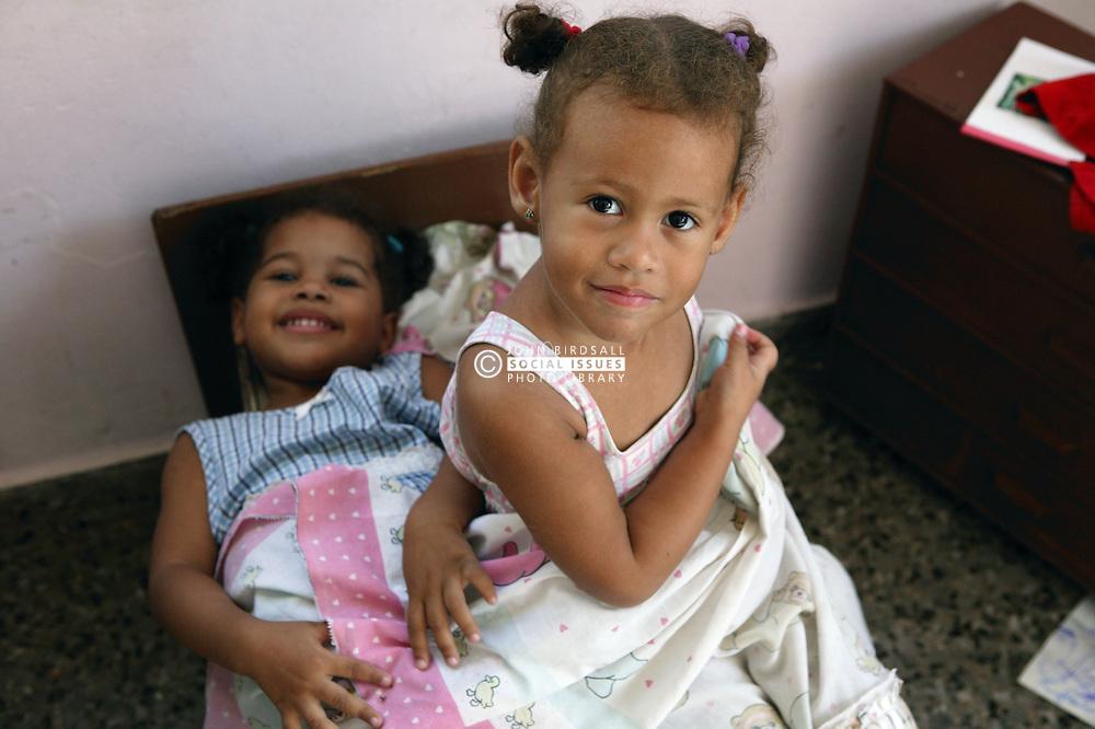 Girls playing in cot at Havana nursery school,