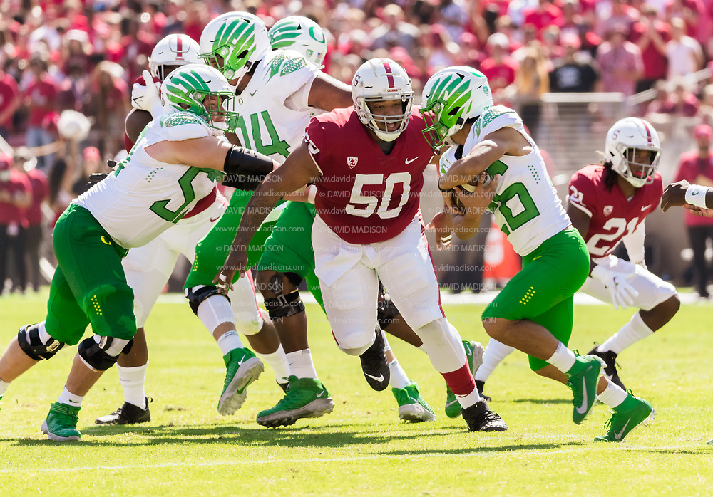 PALO ALTO, CA - OCTOBER 2:  Dalyn Wade-Perry#50 of the Stanford Cardinal attempts to tackle Travis Dye #26 of the Oregon Ducks during an NCAA Pac-12 college football game on October 2, 2021 at Stanford Stadium in Palo Alto, California.  (Photo by David Madison/Getty Images)