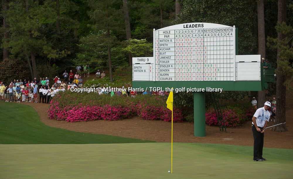 Bubba WATSON (USA) misses par putt at 10th par 4 and made bogey during fourth round US Masters 2014,Augusta National,Augusta, Georgia,USA.