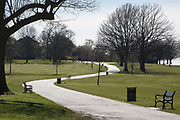 As the second week of the UK governments Coronavirus lockdown ends on a fine Spring weekend, and 24hrs after it was reported that 3,000 Londoners had been counted in Brockwell Park, Herne Hill, resulting in the closure of this significant public green space by Lambeth council, an empty path and grass in the park See an identical view with many people 2 days before in Getty image #1209106121, on 5th April 2020, in London, England.