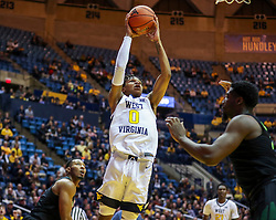 Jan 21, 2019; Morgantown, WV, USA; West Virginia Mountaineers guard Trey Doomes (0) shoots along the baseline during the second half against the Baylor Bears at WVU Coliseum. Mandatory Credit: Ben Queen-USA TODAY Sports
