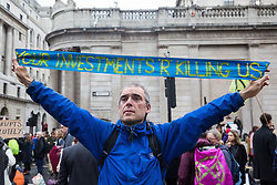 London, UK. 14 October, 2019. A climate activist from Extinction Rebellion blocks roads around the Bank of England on the eighth day of International Rebellion protests across London.