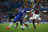 Ngolo Kante of Chelsea in action with Michail Antonio of West Ham United intercepting. Premier league match, Chelsea v West Ham United at Stamford Bridge in London on Monday 15th August 2016.<br /> pic by John Patrick Fletcher, Andrew Orchard sports photography.