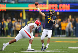 Sep 8, 2018; Morgantown, WV, USA; West Virginia Mountaineers quarterback Will Grier (7) throws a pass during the first quarter against the Youngstown State Penguins at Mountaineer Field at Milan Puskar Stadium. Mandatory Credit: Ben Queen-USA TODAY Sports