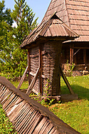 19th century traditional farm house & wicker corn store of the Iza Valley, The Village museum near Sighlet, Maramures, Northern Transylvania .<br /> <br /> Visit our ROMANIA HISTORIC PLACXES PHOTO COLLECTIONS for more photos to download or buy as wall art prints https://funkystock.photoshelter.com/gallery-collection/Pictures-Images-of-Romania-Photos-of-Romanian-Historic-Landmark-Sites/C00001TITiQwAdS8