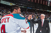 KELOWNA, CANADA - MAY 13: Captain Madison Bowey #4 of Kelowna Rockets high fives General Manger Bruce Hamilton after winning the WHL Championship on May 13, 2015 during game 4 of the WHL final series at Prospera Place in Kelowna, British Columbia, Canada.  (Photo by Marissa Baecker/Shoot the Breeze)  *** Local Caption *** Madison Bowey; Bruce Hamilton;