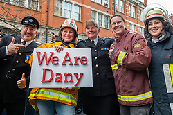 © Licensed to London News Pictures. 23/12/2019. London, UK. London Fire Brigade Commissioner Dany Cotton stands with firefighters from overseas whom hold a 'We Are Dany' placard at a Guard of Honour event in London. Firefighters from across the UK and several from overseas attended the unofficial event outside the brigades headquarters in Union Street. Commissioner Cotton is retiring in the wake of the Grenfell Fire. Photo credit: Peter Manning/LNP