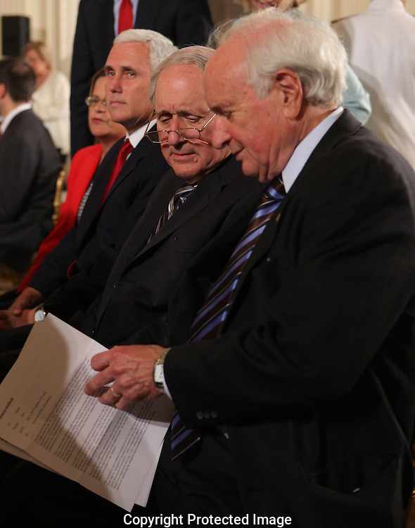 Senator Carl Levin D MI Chairman of the Senate Armed Services Committee, and his brother, Representative  Sander Levin D MI Chairman of the House Ways and Means Committee talk in the East Room of the Whoite House before the signing of the Iran Sanction Act on July 1, 2010.  Photograph by Dennis Brack
