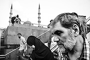 People on the stairs of the underpass just in front New Mosque (Yeni Cami), in Istanbul.