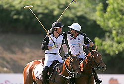 The Duke of Sussex (left) and Nacho Figueras (right) take part in the Sentebale ISPS Handa Polo Cup at the Roma Polo Club in Rome, Italy.