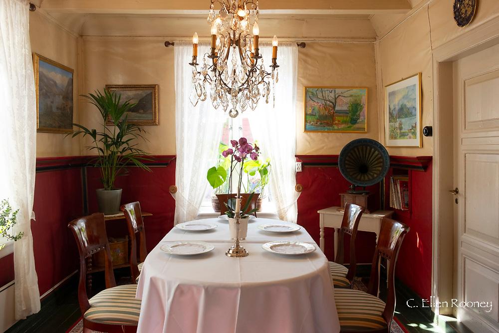 A traditional formal dining room in the Walaker Hotell, Solvorn, Lustra Fjord, Vestlandet, Norway