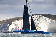 6th April 2021. Hamble. Hampshire . UK. The 'Powerplay' MOD70 racing team skippered by Peter Cunningham and Ned Collier, shown here as they pass the Needles on their world record attempt for the 'Classic Fastnet' route. Leaving from Cowes, rounding the Fastnet Rock in Southern Ireland and crossing the finish line in Plymouth Sound. UK.<br /> Credit - Lloyd Images