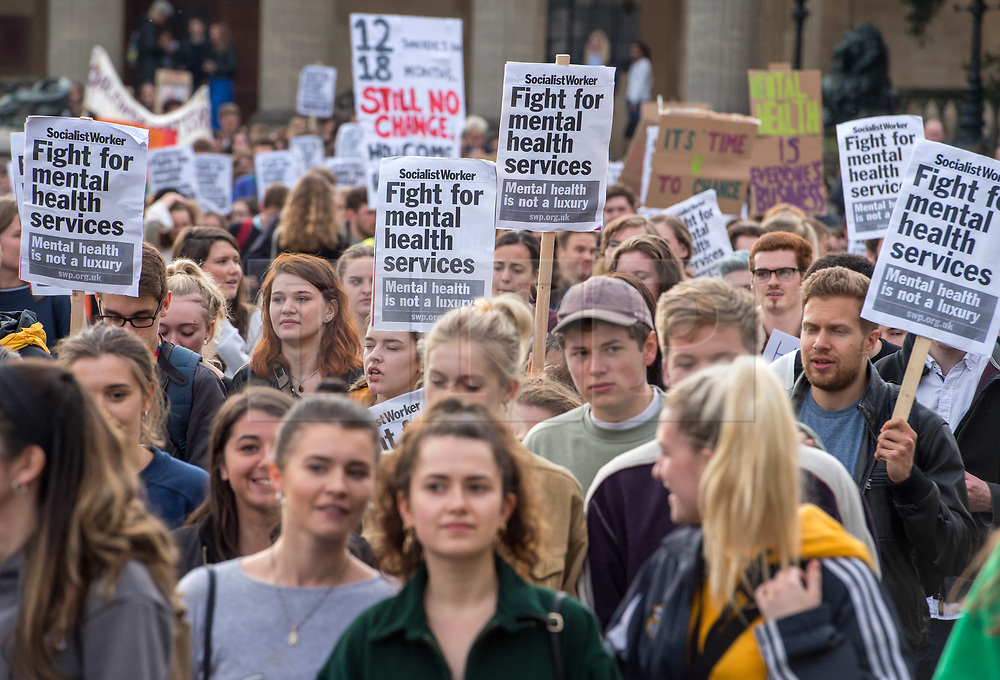 © Licensed to London News Pictures. 25/05/2018. Bristol, UK. Students at the University of Bristol conduct a march demanding better mental health services  and the reinstatement of hall wardens following the news that three students are suspected to have taken their lives within three weeks recently. The march is also in memory of the students who have taken their lives whilst studying at the University, and started at the Wills Memorial Building, ending at Senate House where the Vice-Chancellor's office is located. Last October University of Bristol Vice-Chancellor Professor Hugh Brady signed a Time to Change pledge to raise awareness of mental health issues around the University. But the organisers of the march say the University should live up to the words of that pledge, take a stand and improve student mental health services, and that students should not have to suffer, especially in exam time. The group have described the University's response to the recent students deaths as 'appalling', arguing 'an appropriate response is not a survey but real change and that is what we will be marching for.' Photo credit: Simon Chapman/LNP