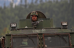 April 27, 2017 - Srinagar, India - Indian army personnel  stand alerts inside  military camp after a suicide attack was carried out by a group of militants in Panzgam 127 Kilometers (79 miles) northwest of Srinagar, Indian controlled Kashmir on Thursday, April 27, 2017. A 70-year-old civilian was killed and seven other civilians were injured during anti-India demonstrations that erupted after Thursday's militant attack. According to army, three Indian soldiers and two suspected rebels were killed during the gun- battle. (Credit Image: © Umer Asif/Pacific Press via ZUMA Wire)