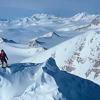 Mountaineer surveys route on Mt. Vaughan in the Trans-Antarctic Range.