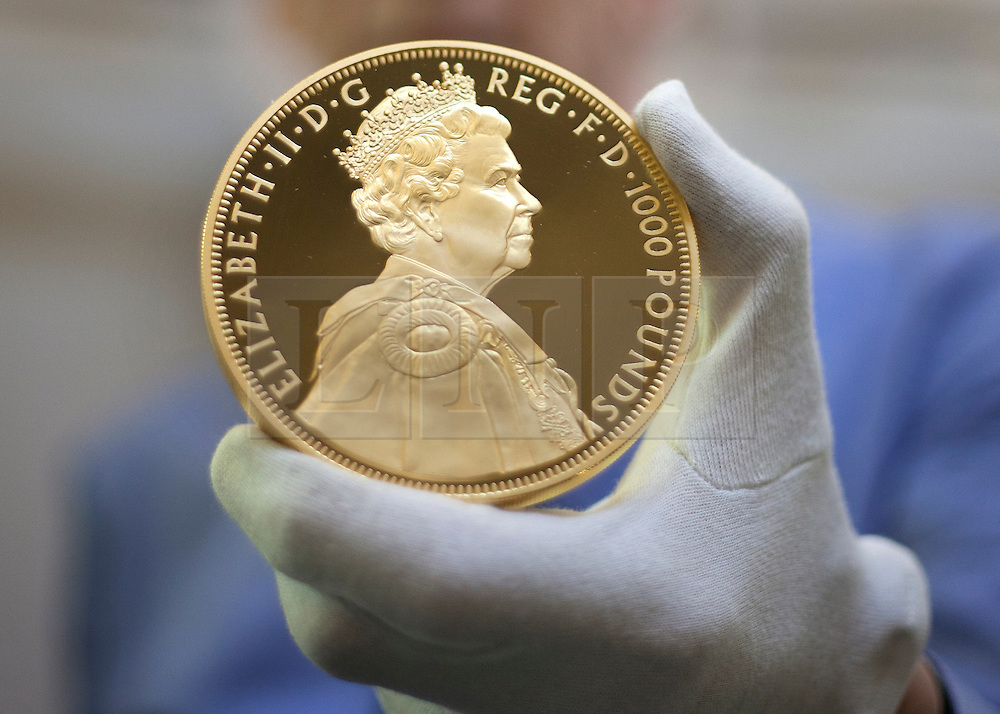 """© licensed to London News Pictures. London, UK 22/06/2012. New one-kilo gold, Diamond Jubilee coin, worth £60,000, goes on display as the Bank of England Museum opens a new free exhibition called """"Gold and the Bank of England"""". Photo credit: Tolga Akmen/LNP"""