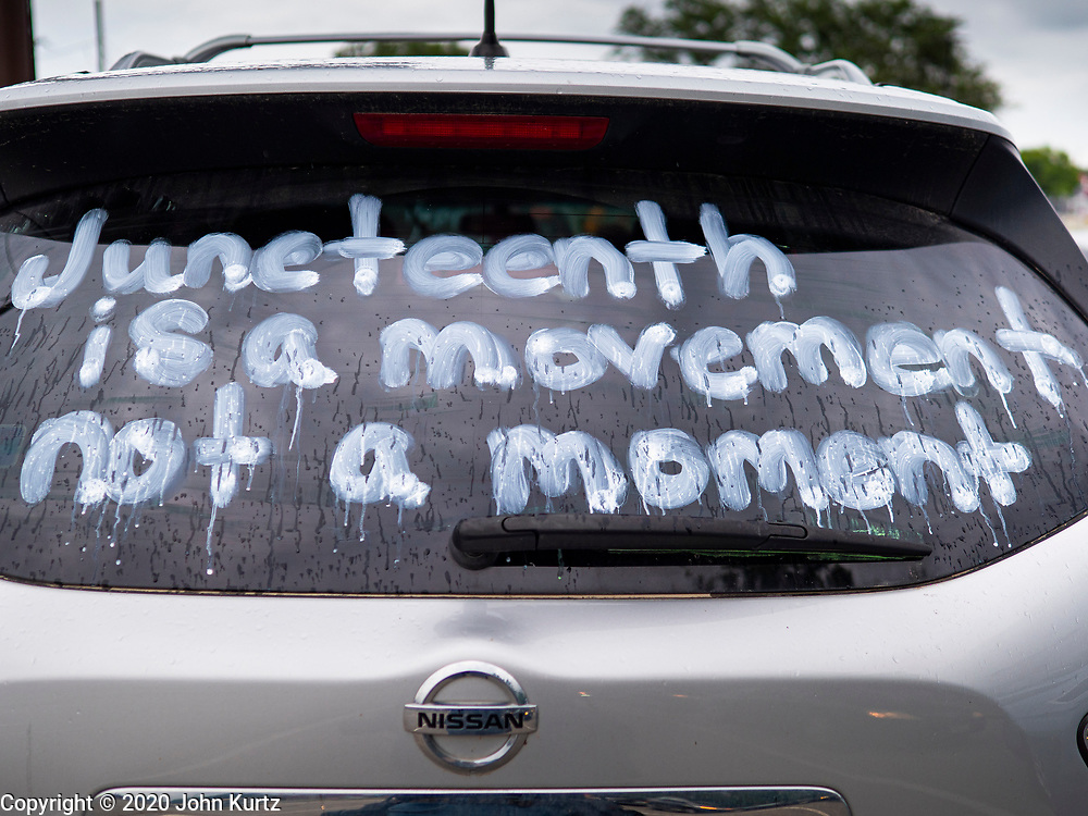 19 JUNE 2020 - DES MOINES, IOWA: A Black Live Matters sign on a car at the State Fairgrounds during Juneteenth celebrations in Des Moines. The caravan drove through the Des Moines metro area. The caravan was called Ride With Us, a Driving March. Hundreds of motorists participated in the rush hour event.        PHOTO BY JACK KURTZ