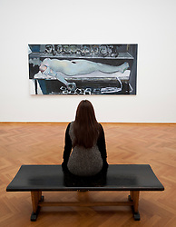 Woman looking at painting Snow White and the broken arm by Marlene Dumas at the Gemeentemuseum in The Hague, Den Haag,  Netherlands