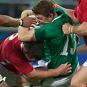 Brian O'Driscoll, Ireland, is tackled by Huw Bennett, Wales, during the Ireland V Wales Quarter Final match at the IRB Rugby World Cup tournament. Wellington Regional Stadium, Wellington, New Zealand, 8th October 2011. Photo Tim Clayton...