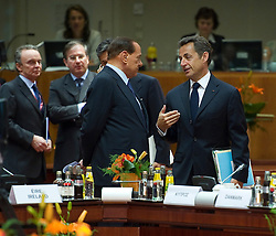 Silvio Berlusconi, Italy's prime minister, left, speaks with Nicolas Sarkozy, France's president, during the European Summit meeting at EU Council headquarters in Brussels, Belgium, on Thursday, June 17, 2010. (Photo © Jock Fistick)