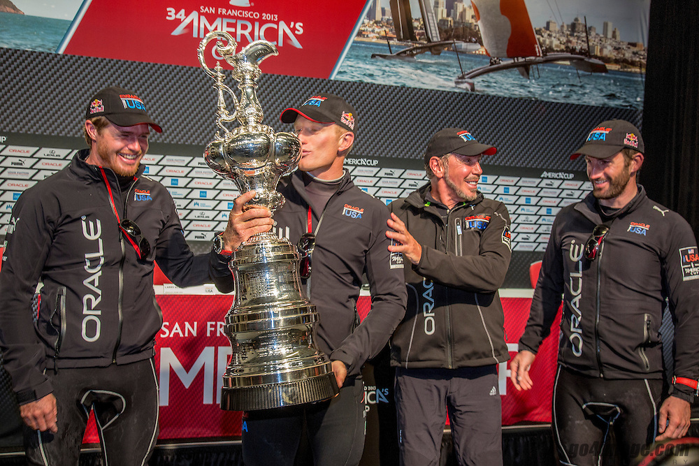 ORACLE Team USA<br /> wins the America's Cup<br /> Race 19<br /> Jimmy Spithill kisses the America's Cup<br /> 2013 America's Cup