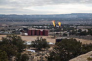Flares burning at fracking industry site on federal land near Counselor, New Mexico. The U.S. Bureau of Land Management has permitted fracking before updating a required resource management plan. Environmental groups and indigenous people are fighting back against the expansion of the fracking industry.