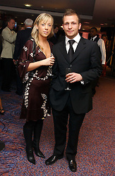 Footballer JODY MORRIS and his wife LOUISE at a sales event for the exclusive Chelsea Bridge Wharf in aid of CLIC Sargeant cancer charity held at Stamford Bridge football stadium, Chelsea, London on 7th February 2006.<br /><br />NON EXCLUSIVE - WORLD RIGHTS