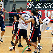 Efes Pilsen's players (Left to Right) Kaya PEKER, Kerem TUNCERI, Ermal KURTOGLU, Charles SMITH, Bootsy THORNTON celebrate victory during their Turkish Basketball league Play Off semi final second leg match Besiktas between Efes Pilsen at the BJK Akatlar Arena in Istanbul Turkey on Wednesday 12 May 2010. Photo by Aykut AKICI/TURKPIX