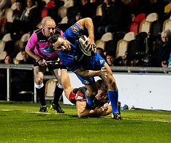 /e11/ evades the tackle of  Jared Rosser of Dragons<br /> <br /> Photographer Simon King/Replay Images<br /> <br /> Guinness PRO14 Round 10 - Dragons v Leinster - Saturday 1st December 2018 - Rodney Parade - Newport<br /> <br /> World Copyright © Replay Images . All rights reserved. info@replayimages.co.uk - http://replayimages.co.uk