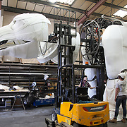 The head is attached to the body using a fork lift and a lot of carful pushing. Aurora is a giant polar bear puppet, the size of a London double decker bus. The bear is the brain child of Greenpeace UK and it will be the center piece in the Greenpeace campaign Save the Arctic  global day of action in London Sept 15th. Aurora is designed by Christopher Kelly in collaboration with props designer Simon Costin and made by Factory Settings in East London.