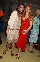 Left to right, FRANCESCA BUSNELLI and CHARLOTTE TILBURY at a fashion show by ISSA held at Cocoon, 65 Regent Street, London on 21st September 2005.<br /><br />NON EXCLUSIVE - WORLD RIGHTS