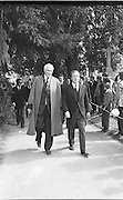 Funeral of Eamon DeValera.   (J72)..1975..02.09.1975..09.02.1975..2nd September 1975..Today saw the funeral of Eamon DeValera. He was laid to rest beside his wife Sinead in Glasnevin Cemetery,Dublin. Dignitries from all around the world attended at the funeral..Image of Charles Haughey (R) leaving the cemetery.