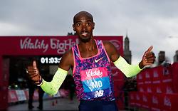 Mo Farah celebrates winning the Vitality Big Half in London City Centre.