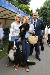 Left to right, LADY CHARLOTTE DINAN with her dog Bilko,  LADY MARY-GAYE CURZON and her dog Poppet and DAVID McDONOUGH at the Macmillan Dog Day in aid of Macmillan Cancer Support held at the Royal Hospital Chelsea, London on 8th July 2008.<br />