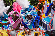 Young Bahamian girls dressed in Junkanoo costumes celebrate graduation in Nassau , Bahamas.
