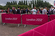 Spectators queue for security checks before the start of the canoe slalom heats at the Lee Valley White Water Centre, north east London, on day 3 of the London 2012 Olympic Games.