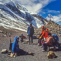 Trekkers atop 17,769 foot Thorang La pass north of Annapurna in Nepal.
