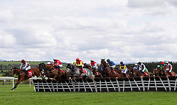 Runners and riders in action during the Adare Manor Opportunity Series Final Handicap Hurdle during day two of the Punchestown Festival at Punchestown Racecourse, County Kildare, Ireland.