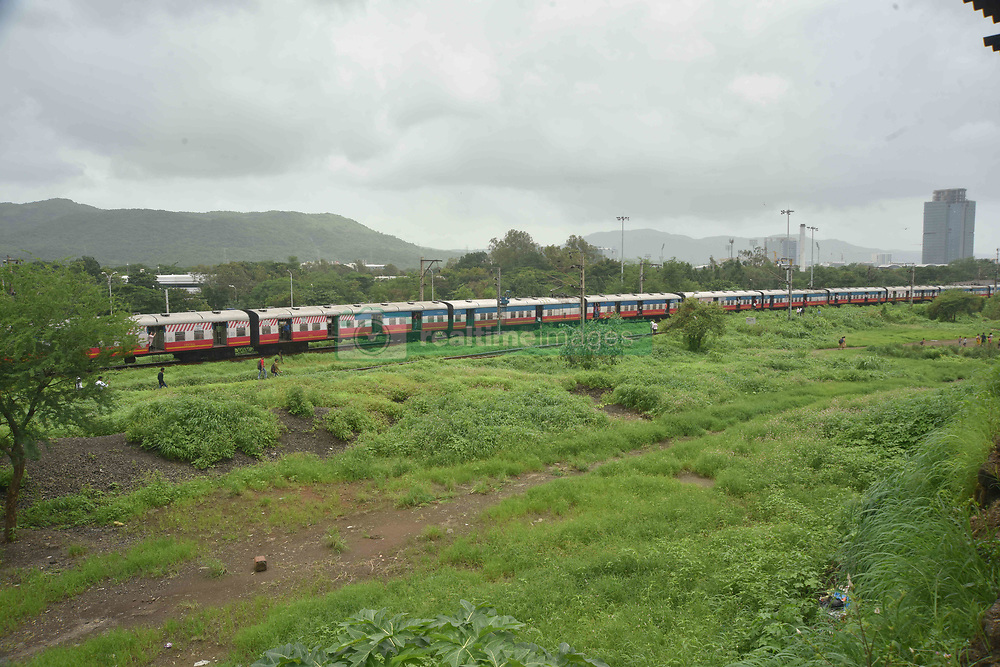 July 25, 2018 - Mumbai, Maharastra, India - 25/07/2018, Mumbai, India, Asia :-Trains lined up in Rabale as Protesters block the Train as Martaha Kranti Morcha call for Maharatsra Bandh as Trains where stopped and Roads where blocked at Ghansoli station and other places as most of the people got stuck in the train or on the platforms no where to go. Maratha Kranti Morcha group called for Bandh for reservations to Maratha's for Government jobs and Education across Maharashtra which also went  Voilent Vandalizing and Burning the Buses and Cars in Mumbai. Sandeep Rasal (Credit Image: © Sandeep Rasal/Pacific Press via ZUMA Wire)