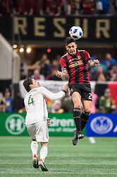 December 8, 2018 - Atlanta, Georgia, United States - Atlanta United defender FRANCO ESCOBAR (2) heads the ball over Portland Timbers defender JORGE VILLAFANA (4) during the MLS Cup at Mercedes-Benz Stadium in Atlanta, Georgia.  Atlanta United defeats Portland Timbers 2-0 (Credit Image: © Mark Smith/ZUMA Wire)